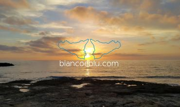 beautiful sunset in punta secca facing montalbano house